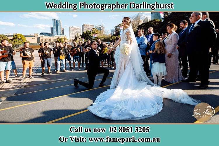 Groom kneeling in front of Bride Darlinghurst NSW 2010