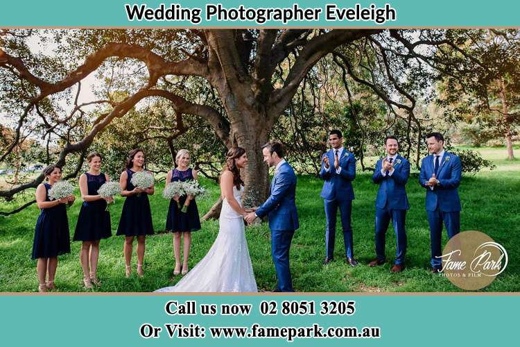 Bride and Groom with their secondary sponsor during the ceremony Eveleigh NSW 2015