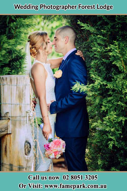 The couple's hold each other in the garden Lodge