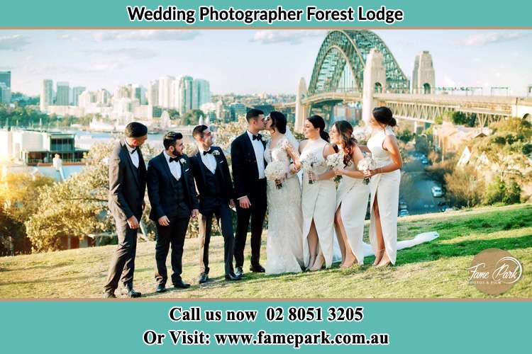 The bride and Groom at the hill with their secondary sponsor Forest Lodge