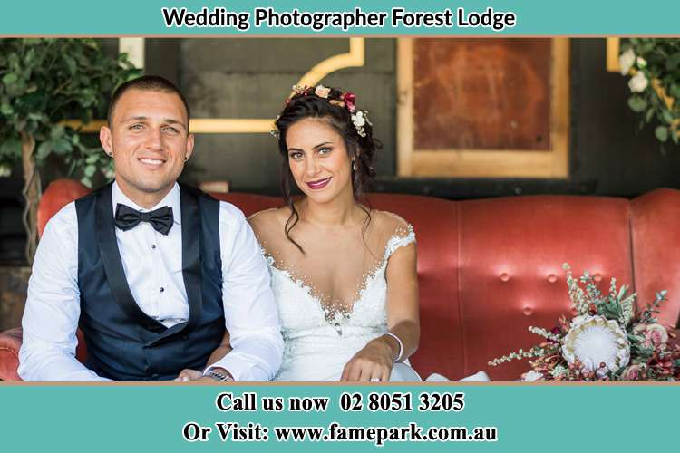 Bride and Groom sitting at the couch Forest Lodge NSW 2037