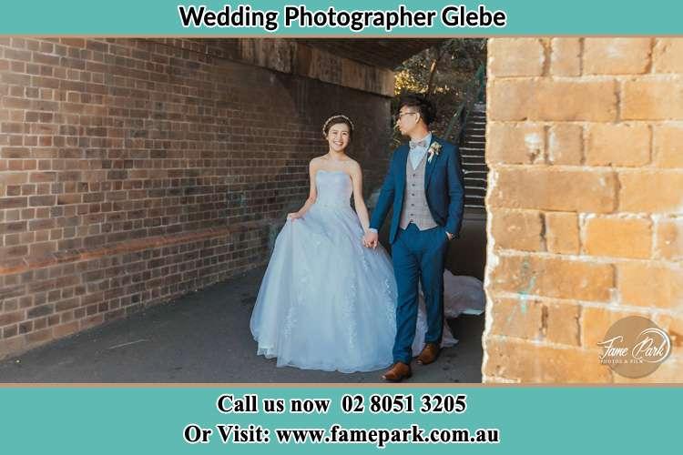 Bride and Groom walking around the corner Glebe NSW 2037