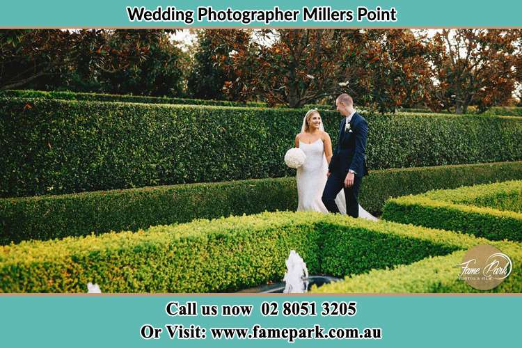 Bride and Groom walking in the garden Millers Point NSW 2000
