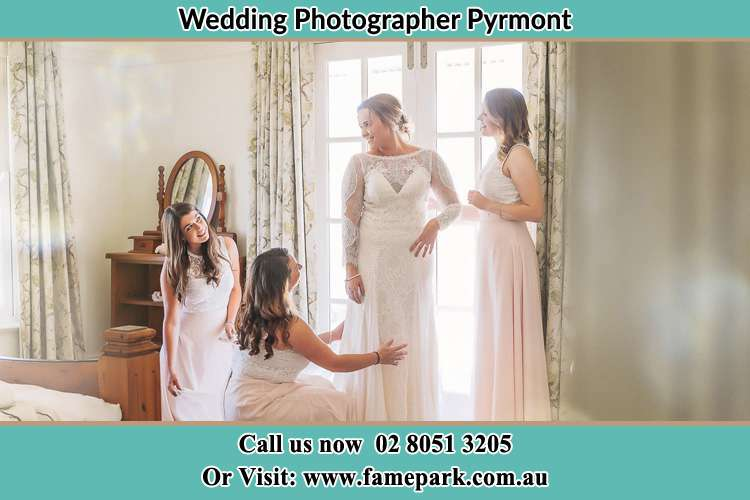 Bride preparing together with her bride's maids Pyrmont NSW 2009