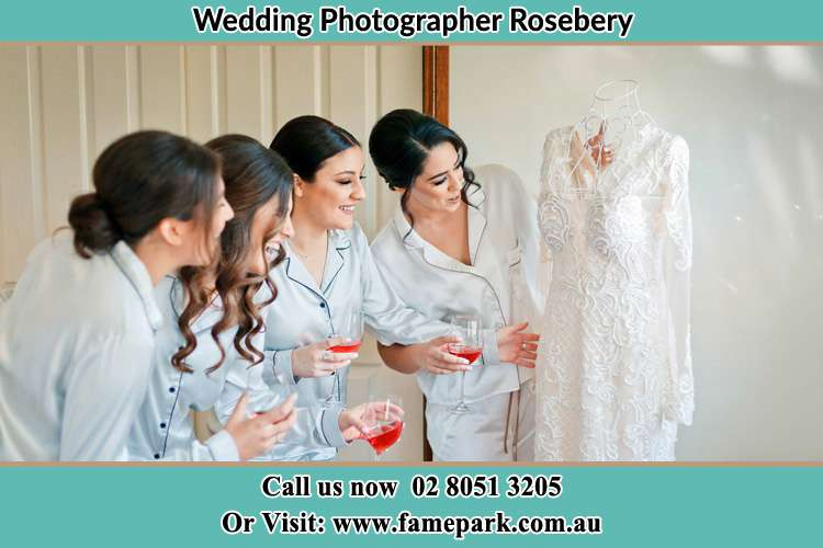 The Brides Looking at her wedding gown with the Bride's maids Rosebery