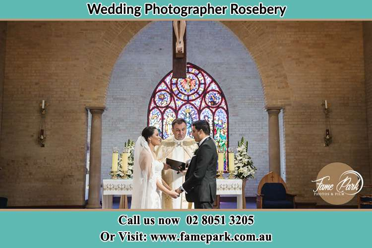 Bride and Groom with Priest at the altar Rosebery NSW 2018