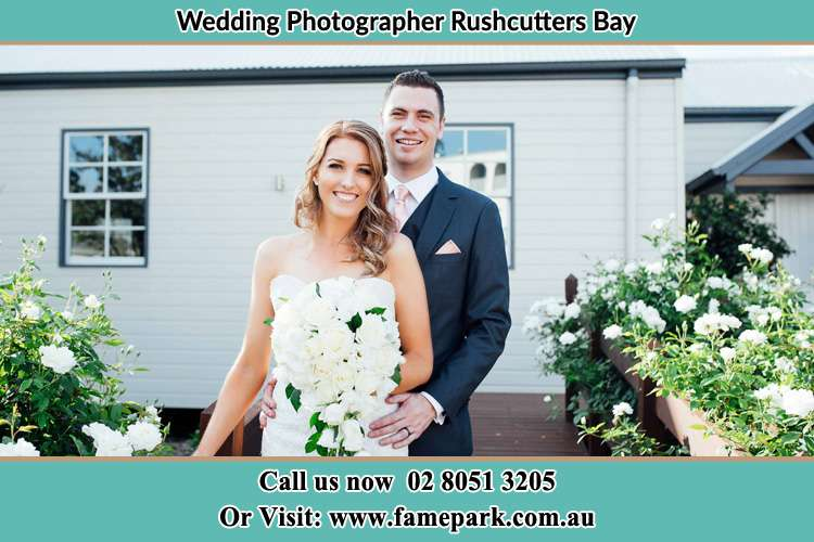Bride and Groom in front of the house Rushcutters Bay NSW 2011