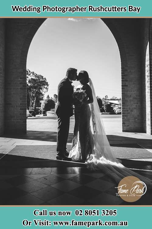 The Couples kiss in front of a church Rushcutters Bay