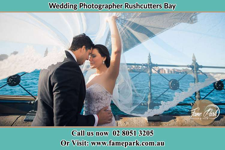 The bride and Groom at the shore Rushcutters Bay