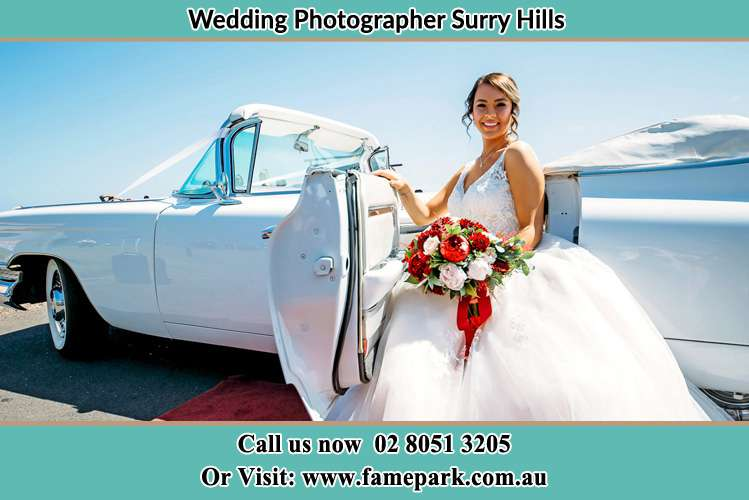 Bride sitting at the Bridal car Surry Hills NSW 2010