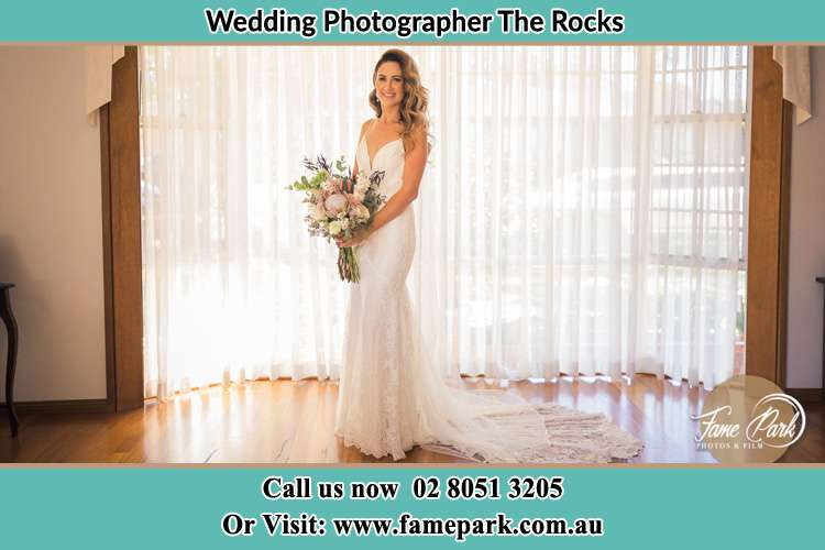 Bride hold bouquet of flowers near the window The Rocks NSW 2000