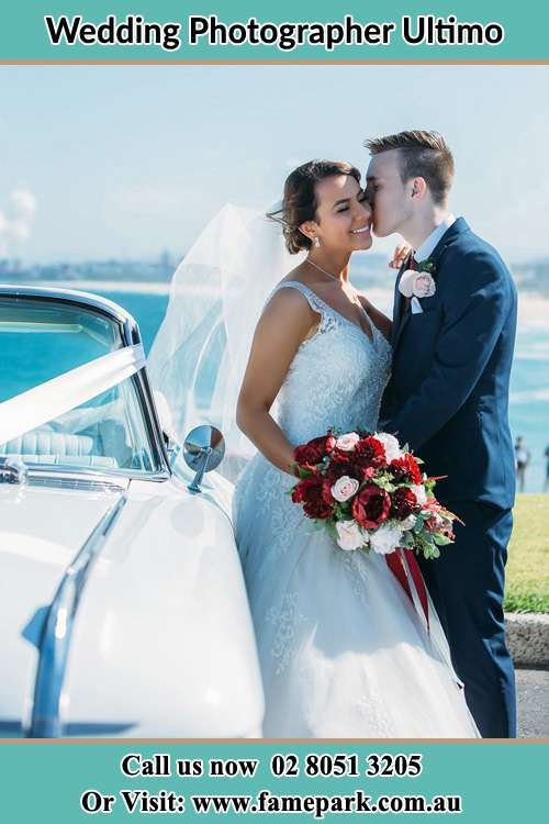 Groom kissed the Bride beside the Bridal car Ultimo NSW 2000