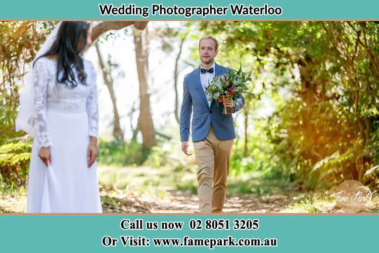 Groom bring Bouquet of flowers to the Bride Waterloo NSW 2017