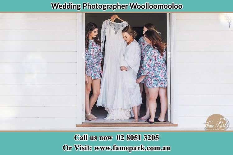 Bride looking at her gown Woolloomooloo NSW 2011