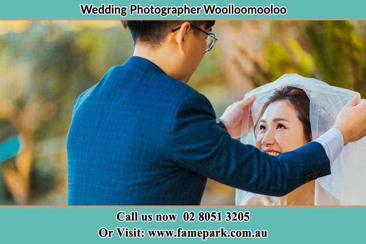 The Groom hold the veil of the Bride Woolloomooloo