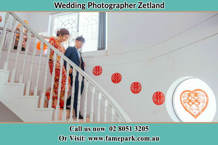 The Bride And Groom walking down the staircase Zetland